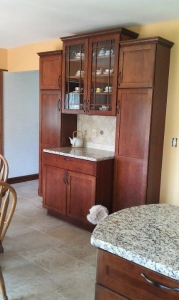 Finished cabinetry with serving counter and pantry storage