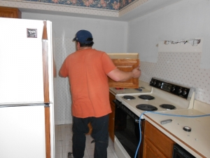 Removing the old cabinetry and appliances