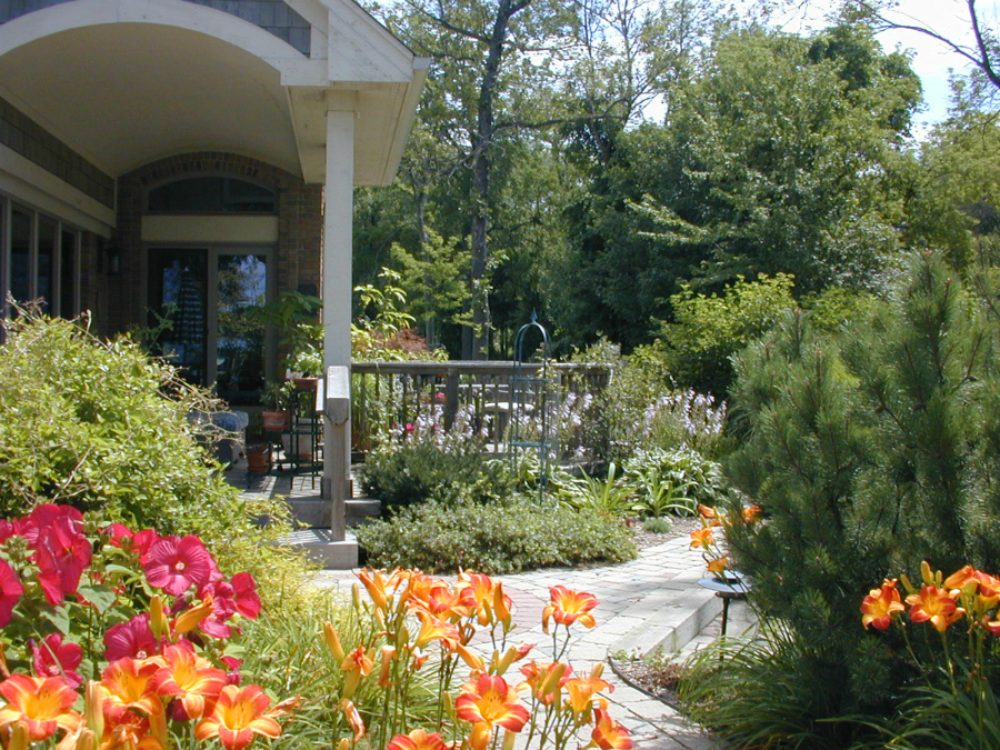 Back yard deck and landscaping create an outdoor living oasis.