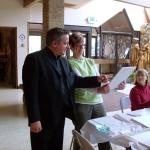 Fr. Chris Maus and Karen Geno admire a large tile.